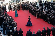 The world's a stage: Eva and Aishwarya make their way up the red carpet...