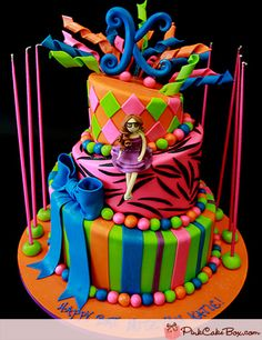A mix of bright colors including lime, pink and black, zebra stripes pattern & hot pink fondant