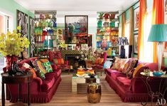 Sig Bergamin's Sao Paulo living room features intense colors and a great mix of periods, colors, textures, fabrics, materials and cultures. Click thru to see a nice big photo. Love it!
