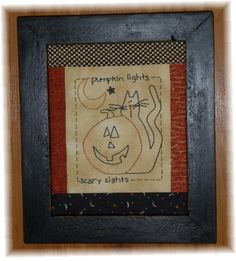 you could find cute halloween material to outline the stitchery