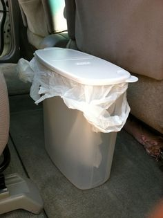 trash can for the car: plastic cereal container + plastic shopping bag
