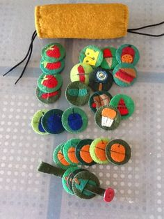 Cutest craft ever! Make a #felt game for your little one to practice fine motor skills and counting along to Eric Carle's story of The Very Hungry Caterpillar! via #mamapeapod #finemotor #veryhungrycaterpillar