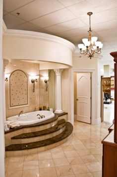 This to me is the ultimate spa experience for your home- a beautiful raised soaking tub in a room of nothing but luxury! This is the style I would like to give all my clients! Rustic Bathroom Shelves, Rustic Bathroom Designs, Rustic Bathroom Vanities, Bathroom Ideas, Dream Bathrooms, Beautiful Bathrooms, Luxury Bathrooms, Dream Rooms, Cabin Design