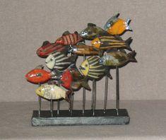 Poissons H : 25, L : 18 - Anne de SAUVEBOEUF céramiste sculpteur animalier - méthode du Raku travail visible au 74 rue du cherche-midi, Paris 6