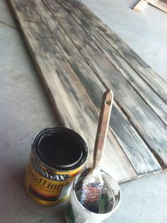 Easy and Quick DIY Faux Barn wood effect.  Start with new wood. Then with the paintbrush, paint a layer of water and then a layer of stain and rub it off quickly with a rag to get that gray color. The water keeps the stain from getting too far in the wood so it'll be gray not black.