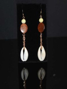 Coastal Christmas gift. Use code SHOPSMALL150 for discount! Unique styled custom sea shell cowrie and wood combo dangle earrings. Something fun and trendy for an evening night out! #shopsmall150