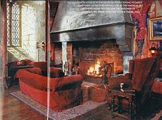 I want this big old fireplace in a home library one day - but with comfy leather chairs instead of the crimson ones. I love that you can practically walk inside that fireplace.