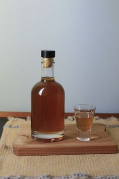 bottle of hazelnut liqueur and a cordial glass