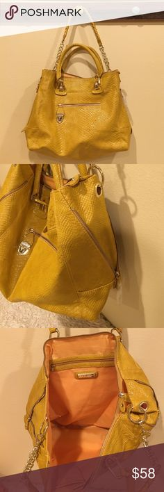 "🆕 Steve Madden gold/yellow faux snakeskin bag Gorgeous gold and yellow handbag by Steve Madden. Has optional shoulder strap, front zip and snap pocket, interior zip pocket and pouch. Side have zippers to expand bag. Measures 15"" across base and 13"" tall. NWT - this color is hot!! Steve Madden Bags"