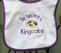 Mardi Gras Bib They Found Me In A Kingcake Purple Trim. $8.99, via Etsy.