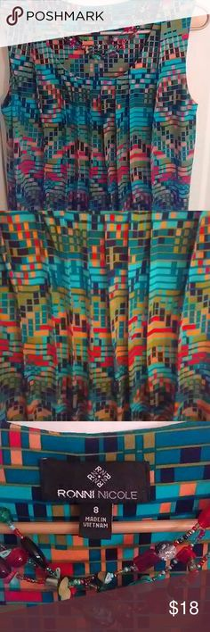 """Aztec/Boho Dress Really cute dress with fibrant colors of teal,orange,black,and yellow make this little number a show stopper.Pleating at the neck gives this dress style and a bit of a swing dress quality. Nice poly stetch knit. Not too short. 29"""" long from underarm. Worn once. RonnieNicole Dresses Midi"""