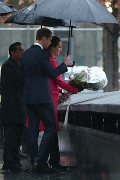 Prince William, Duke of Cambridge and his wife Catherine, Duchess of Cambridge, lay flowers at the Memorial Reflection Pool during their during a visit to the National September 11 Memorial Museum on December 9, 2014 in New York City.