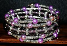 This stunning wrap bracelet is finished with purple glass beads, purple acrylic pearls and a variety of eye catching Tibetian silver style metal spacer beads, creating a unique statement piece that is sure to be noticed. All wrap bracelets are one size fits all, however, if you have any specific requirements then please contact us. With every bracelet order you will receive a beautiful drawstring pouch (see photo). Please note that the pouch design is selected at random but with the items…
