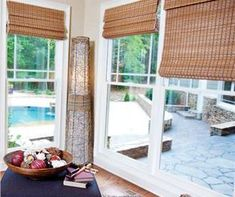Bamboo shades are perfect for layering windows and give great texture to a space!  Love these via www.paylessdecor.com
