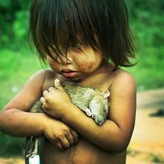 Indigenous child from amazon crying over loss of his pet