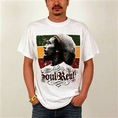 """This white Bob Marley Men's Tee shows Bob in front of rasta colors with the words """"Soul Rebel"""" written in script below."""