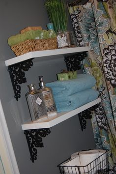 FLOATING SHELVES WITH HOBBY LOBBY IRON BRACKETS...you'd be surprised how many random slabs of wood I have around the house just looking for a place on my wall. must try!
