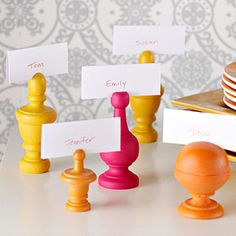 bhg's finial place card holders - & I love 1825's idea of using them for photos. Would be great with chess pieces