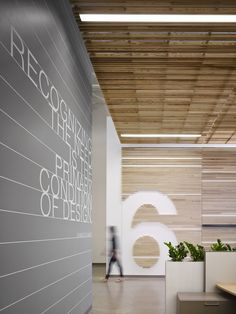 "The large numbers situated along the walls represent the Design Center's ""immersion labs"" – special areas designed to spark innovation and collaboration among nearly 100 design professionals 