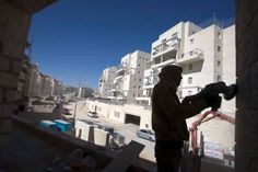 West Bank Land seized under arcane 'state land' rule, is being given to Israeli settlers. A Palestinian labourer works at a construction site in a Jewish settlement near Jerusalem known to Israelis as Har Homa and to Palestinians as Jabal Abu Ghneim.