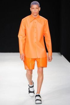 Christopher Shannon SS14 | Orange Is New Black | The parade of tones of orange – delicious tangerine, pumpkin, salmon, coral, burnt-orange and fresh orange peel – is evident of the strong trend and creative vision which designers are delivering through their garments across many menswear fashion labels. Gentlemen on the cutting edge of styling are embracing this flaming, brilliant and bold colour. #CaribbeanMenswear #CaribbeanLifestyle http://acubien.com/orange-is-the-new-black/