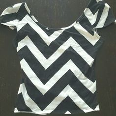 Charlotte Russe S Crossback Cute crossback shirt, only worn a few times. Does have small area along bottom where the stitch has come off. Stretchy fabric, fits like a tighter crop top. Charlotte Russe Tops Crop Tops