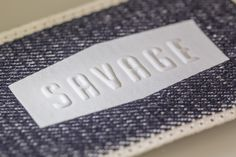 Heat-transfer patch with embossed logo made in Italy by Panama Trimmings