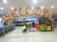 """""""WELCOME"""" megaloon archway for a local festival. Gold foils here but also available in classic Silver foil"""
