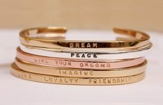 jewels bangle bracelets jewelry accessories bling quote on it love dream peace friendship imagine live your dreams love loyalty friendship new years resolution Jewelry Box, Jewelry Accessories, Fashion Accessories, Fashion Jewelry, Jewlery, Love Bracelets, Cartier Love Bracelet, Friendship Bracelets, Layering Bracelets
