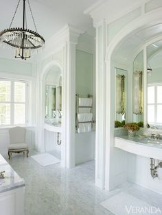 """Unstuffy Elegance"". An unstuffy elegance fills this sunlight-washed master bathroom.French 19th century chandelier, Treilage. INTERIOR DESIGN BY BUNNY WILLIAMS. Credit: Francesco Lagnese."