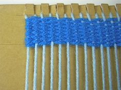 How to weave on a cardboard loom.