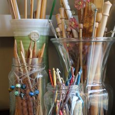knitting needles in mason jars