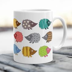 What do you think about this design? Tag someone who would like to use this coffee cup?  #hedgehoglovedotcom  Available on http://hedgehoglove.com  This Adorable Hedgehog themed sturdy white glossy ceramic mug is an essential to every Hedgehog lover.  11oz Ceramic mug Dishwasher safe Microwave safe Two-sided print White Glossy Made and printed in the USA