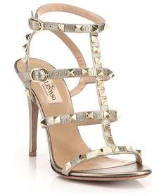 "rockstud metallic leather gladiator sandals by Valentino. Signature rockstuds illuminate metallic gladiator style. Self-covered heel, 4.13"" (105mm).Metallic leather upper with..."