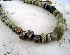 "3 elements necklace - salt marsh; cold glazed earthenware beads, ""dragon skin"" steel and bronze; aquamarine and tourmaline on leather; kathy van kleeck"