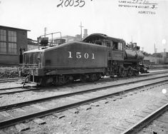 """Chicago, St. Paul & Pacific switch engine in Spokane, WA. The car is labeled """"1501"""" and """"C.M & ST. P. 15."""" Ca. 1925."""