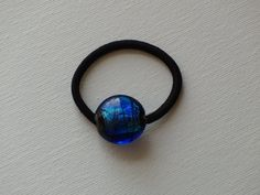 Blue with black and turquoise foil lampwork round glass bead, ponytail holder, by two dot designs