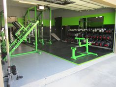 Dedicated garage gym complete with flooring rack ghd and bag