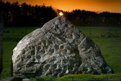 Beltany Stone Circle - Sunrise at Beltaine is aligned with the only decorated stone in the circle (photo by Ken Williams)
