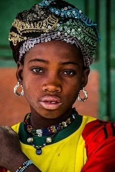 A girl in a Burkina Faso market place.