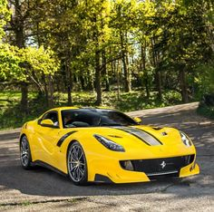 Ferrari F12 TDF painted in Giallo Tristrato w/ Silver and Black central stripes Photo taken by: @xricox on Instagram