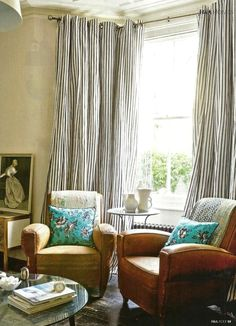 blue and white ticking drapes and leather club chairs and floral. A nice mix. she moves the furniture CURTAINS Leather Club Chairs, Leather Sofas, Striped Curtains, Long Curtains, Home And Living, Modern Living, Living Spaces, Living Rooms, Family Room