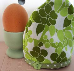 A cute egg cosy and co-ordinating egg cup, painted in Laura Ashley Hedgerow. Available from our Eden Home Solutions store on Etsy. Click to visit our store and see more exciting hand made items - we can custom make orders too! Photo styled by Eden Home Solutions