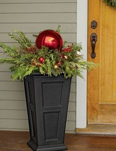 A Tall Planter with the Look of Custom-Crafted Wood in Durable, Easy-to-Maintain Material