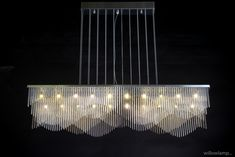 Steamwave Chandelier StreamWave is a very unusual dynamic chandelier that plays with one's perception as it appears to transform from different viewpoints in subtle ways. The design is composed of staggered waves which evoke a subtle feeling of rhythmic movement. Illuminated by 20x G4 LEDs. #BespokeChandelier #LinearChandeliers #LEDChandeliers #DiningRoomChandeliers #LuxuryInteriors #ModernPendantLights Linear Lighting, Linear Chandelier, Contemporary Chandelier, Modern Pendant Light, Chandelier Lighting, Chandeliers, G4 Led, Reception Counter, Higher Design