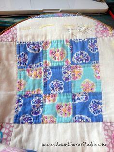 In my quilt hoop: hand quilting a 9 patch block. © Stephanie Boon, 2015 www.DawnChorusStudio.com