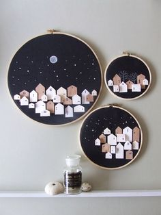 "They all slept under the same stars but each had their own dream to dream. Handmade Houses on Hoop art in Neutral colours for any Wall decor A set of 3 of ttiny wooden towns as pictured. *1 x 6 inch hoop *1 x 8 inch hoop *1 x 12 inch hoop Images of the 3 hoops are in ""neutral"" colour scheme but you can choice the solours shown in image 3. or send us a convo for custom colours. These tiny wooden houses are carved from balsa wood and handpainted and simply detailed. Their background is a black…"