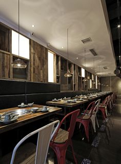 """""""We create a kind of natural and fashionable youthful diet experience by using and combining a big amount of old wood, metal plate and texture cement wall according to the new definition of this fish restaurant by the client."""""""