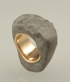 "Ring - JIM COTTER-USA - Cement and 14k gold ""My work consists of creating images from a variety of materials not normally associated with jewelry such as steel, concrete, rocks and sought after everyday objects."""