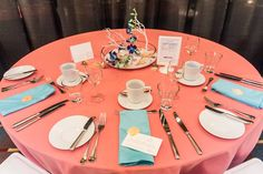 Tropical feel to this coral and robin's egg napkins. Shell and sand accents.